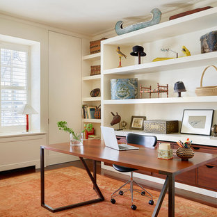 Asian study room in Chicago with white walls, a freestanding desk and dark hardwood floors.