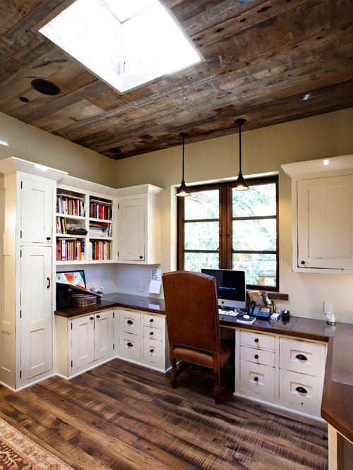 rustic brown floor home office idea in san francisco with beige walls