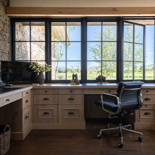 Inspiration for a cottage built-in desk dark wood floor and brown floor study room remodel in Other with gray walls
