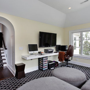 Inspiration for a transitional built-in desk home office remodel in Chicago with yellow walls