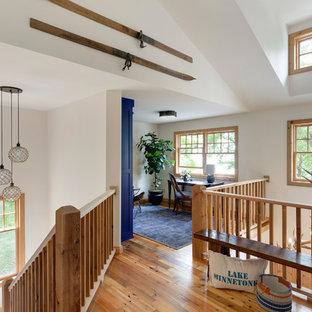 Study room - coastal freestanding desk medium tone wood floor study room idea in Minneapolis with white walls and no fireplace