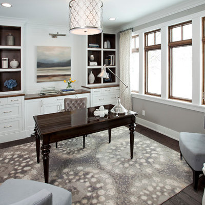 Large transitional freestanding desk dark wood floor home office photo in Minneapolis with gray walls