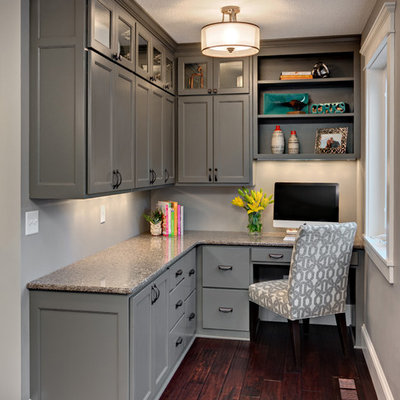 Example of a mid-sized classic built-in desk dark wood floor home office design in Minneapolis with gray walls and no fireplace