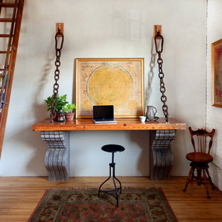 Inspiration for an industrial built-in desk home office remodel in Portland Maine