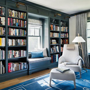 Example Of A Large Coastal Freestanding Desk Light Wood Floor And Blue Home Office Library