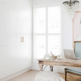 Mid-sized beach style study room in Sydney with white walls, a freestanding desk, light hardwood floors and beige floor.