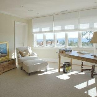 サンタバーバラの中くらいのビーチスタイルのおしゃれな書斎 (カーペット敷き、自立型机、ベージュの床、ベージュの壁、コーナー設置型暖炉、レンガの暖炉まわり) の写真