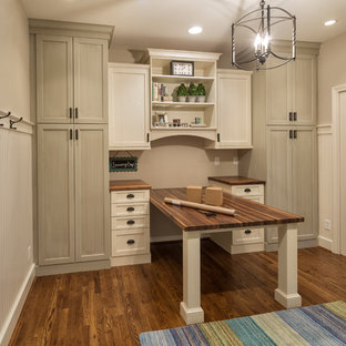 Example of a large transitional dark wood floor home office design in Cincinnati with gray walls