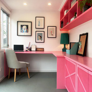 Mid-sized eclectic home office in Melbourne with a built-in desk.