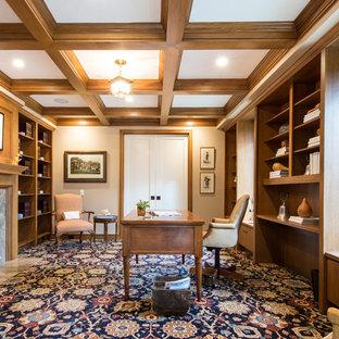 サンディエゴの大きいトランジショナルスタイルのおしゃれな書斎 (ベージュの壁、カーペット敷き、標準型暖炉、石材の暖炉まわり、自立型机、マルチカラーの床) の写真