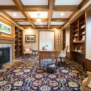 ロサンゼルスの大きいトランジショナルスタイルのおしゃれなホームオフィス・書斎 (ライブラリー、ベージュの壁、カーペット敷き、標準型暖炉、石材の暖炉まわり、自立型机、青い床) の写真