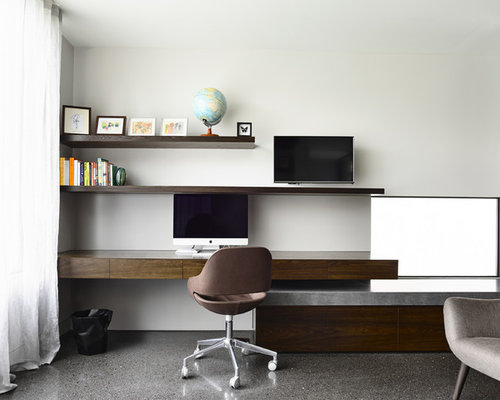 Inspiration for a modern built-in desk concrete floor study room remodel in  Melbourne with