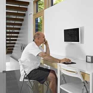Example of a minimalist gray floor home office design in Edmonton with white walls