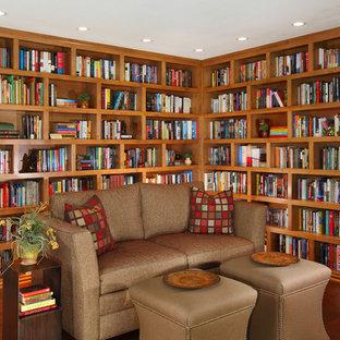 Imagen de despacho de estilo americano, de tamaño medio, con paredes marrones, suelo de madera oscura, suelo marrón, chimenea tradicional y marco de chimenea de baldosas y/o azulejos