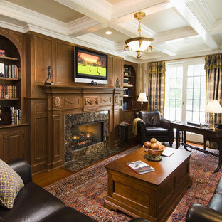 Example of a large classic freestanding desk dark wood floor home office design in Bridgeport with a standard fireplace and a stone fireplace