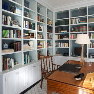 Inspiration for a mid-sized timeless freestanding desk dark wood floor and brown floor home office library remodel in New York with blue walls and no fireplace