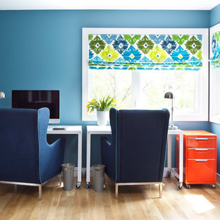 Inspiration for a contemporary freestanding desk light wood floor home office remodel in Denver with blue walls
