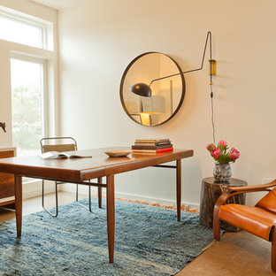 Inspiration for a modern freestanding desk home office remodel in Los Angeles with white walls