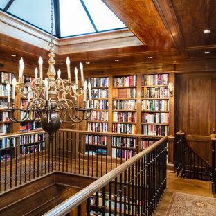 На фото: огромный кабинет в стиле современная классика с библиотекой, коричневыми стенами, паркетным полом среднего тона и встроенным рабочим столом без камина