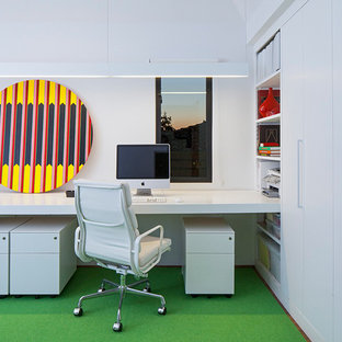 Study room - mid-sized contemporary built-in desk carpeted study room idea in Los Angeles with white walls