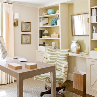 Inspiration for a beach style freestanding desk dark wood floor home office remodel in Boston with beige walls