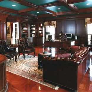 Large ornate freestanding desk study room photo in Chicago with brown walls