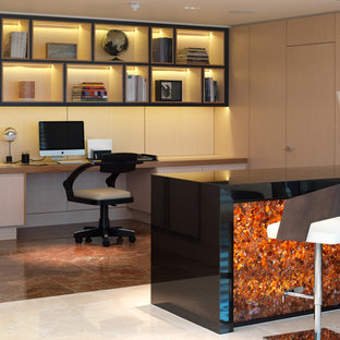 Inspiration for a contemporary built-in desk brown floor study room remodel in London with beige walls