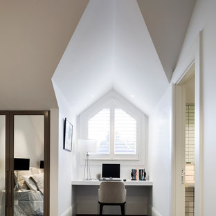 Photo of a mid-sized contemporary home office in Sydney with white walls, carpet, no fireplace, grey floor and a built-in desk.
