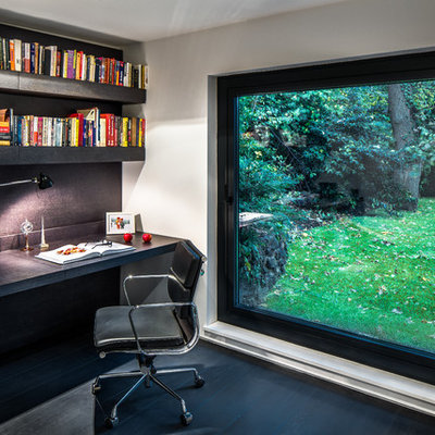 Inspiration for a contemporary built-in desk dark wood floor study room remodel in Other with white walls