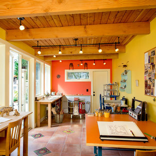 Photo of a home studio in Seattle with yellow walls, terracotta flooring and a freestanding desk.