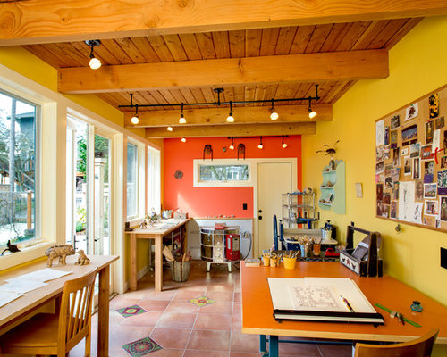 Example Of A Southwest Home Studio Design In Seattle With Yellow Walls,  Terra Cotta