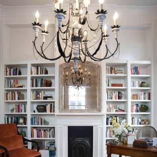 Design ideas for a large classic study in New Orleans with beige walls, medium hardwood flooring, a standard fireplace, a metal fireplace surround, a freestanding desk and brown floors.