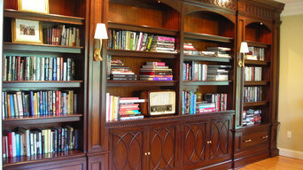 Mahogany library cabinetry with carved mouldings