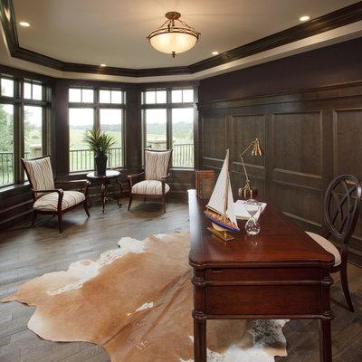 Elegant freestanding desk dark wood floor home office photo in Calgary