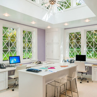 Inspiration for a transitional built-in desk carpeted and beige floor home studio remodel in Philadelphia with purple walls