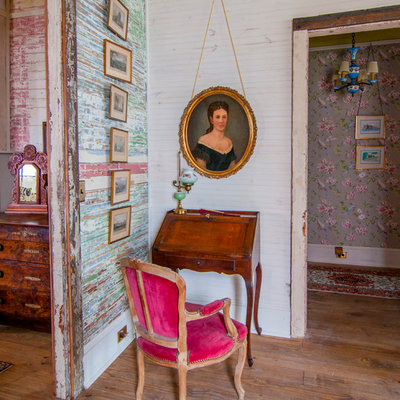 Small eclectic freestanding desk medium tone wood floor study room photo in New Orleans with multicolored walls