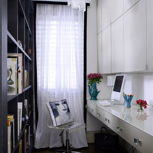 Home office library - mid-sized transitional built-in desk dark wood floor and brown floor home office library idea in London with white walls and no fireplace