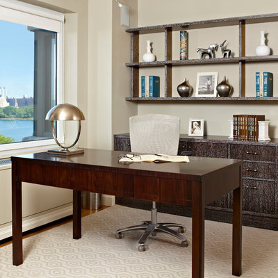 Study room - large transitional freestanding desk light wood floor study room idea in New York with beige walls and no fireplace