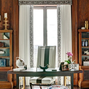 Huge ornate freestanding desk dark wood floor study room photo in New York