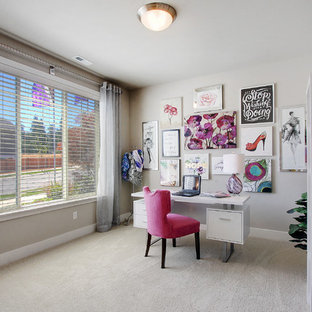 Example of a mid-sized transitional freestanding desk carpeted and beige floor home office design in Seattle