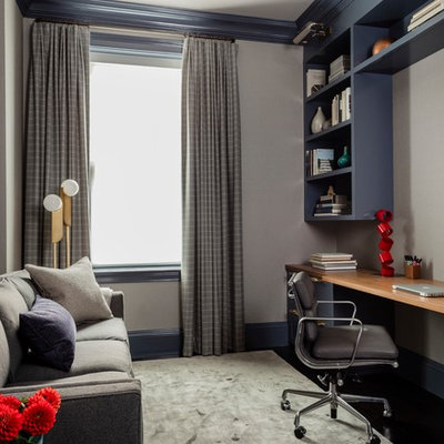 Mid-sized transitional built-in desk carpeted and gray floor study room photo in Boston with gray walls
