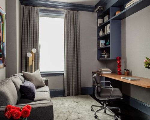 mid sized transitional built in desk carpeted and gray floor study room photo in