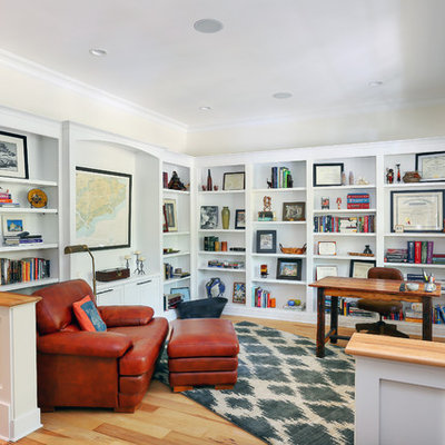 Inspiration for a mid-sized timeless freestanding desk medium tone wood floor study room remodel in Charleston with beige walls