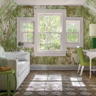 Design ideas for a world-inspired home office and library in Other with multi-coloured walls, dark hardwood flooring, a freestanding desk and brown floors.