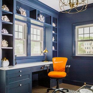 ボストンの大きいトランジショナルスタイルのおしゃれな書斎 (青い壁、淡色無垢フローリング、造り付け机、ベージュの床) の写真