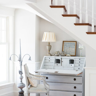 Cottage chic freestanding desk medium tone wood floor study room photo in Boston with white walls