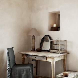 Study room - shabby-chic style freestanding desk study room idea in London with beige walls