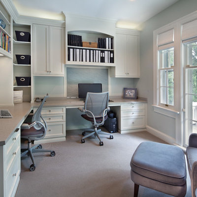 Example of a transitional built-in desk home office design in DC Metro