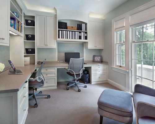 example of a transitional home office design in dc metro with a built in desk