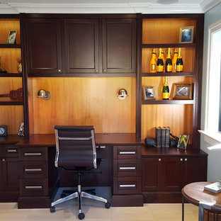 Mid-sized island style built-in desk porcelain tile home office photo in Other with blue walls and no fireplace